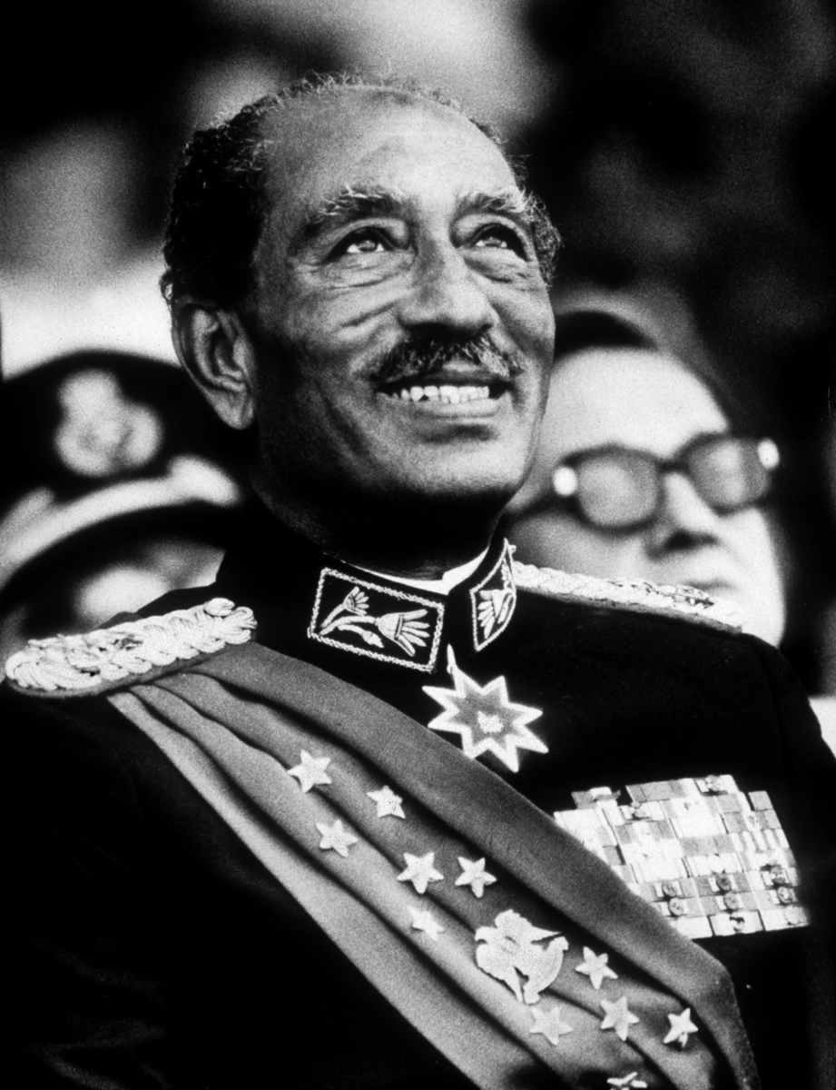 The Last Smile-Egyptian President Anwar Sadat smiles moments before he was assassinated  at the annual military parade. Oct. 6, 1981.