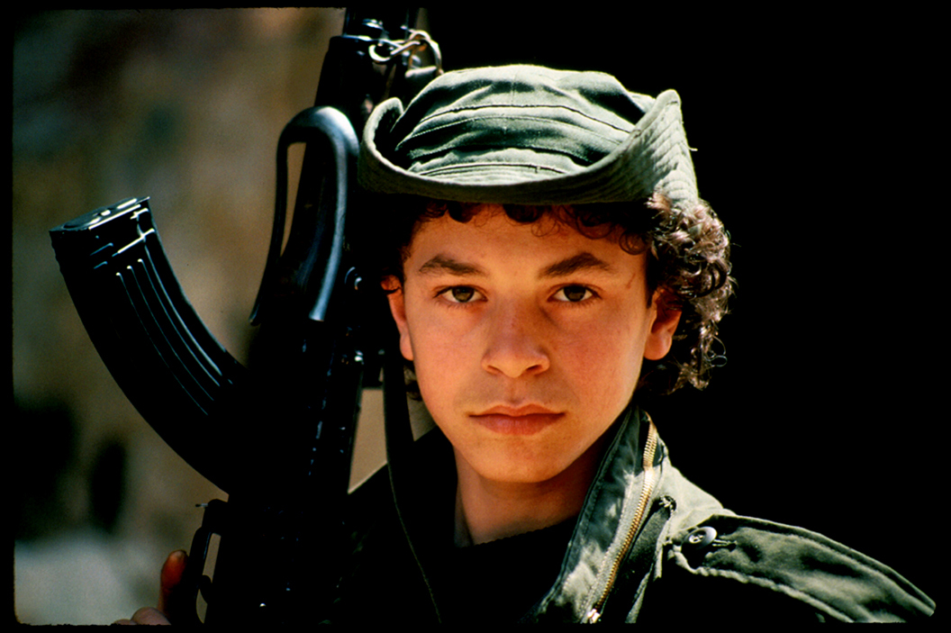 """Bird"" 15 year old fighter with AK-47 rifle, West Beirut 1985. : Lebanon 1981-2008 : BILL FOLEY"
