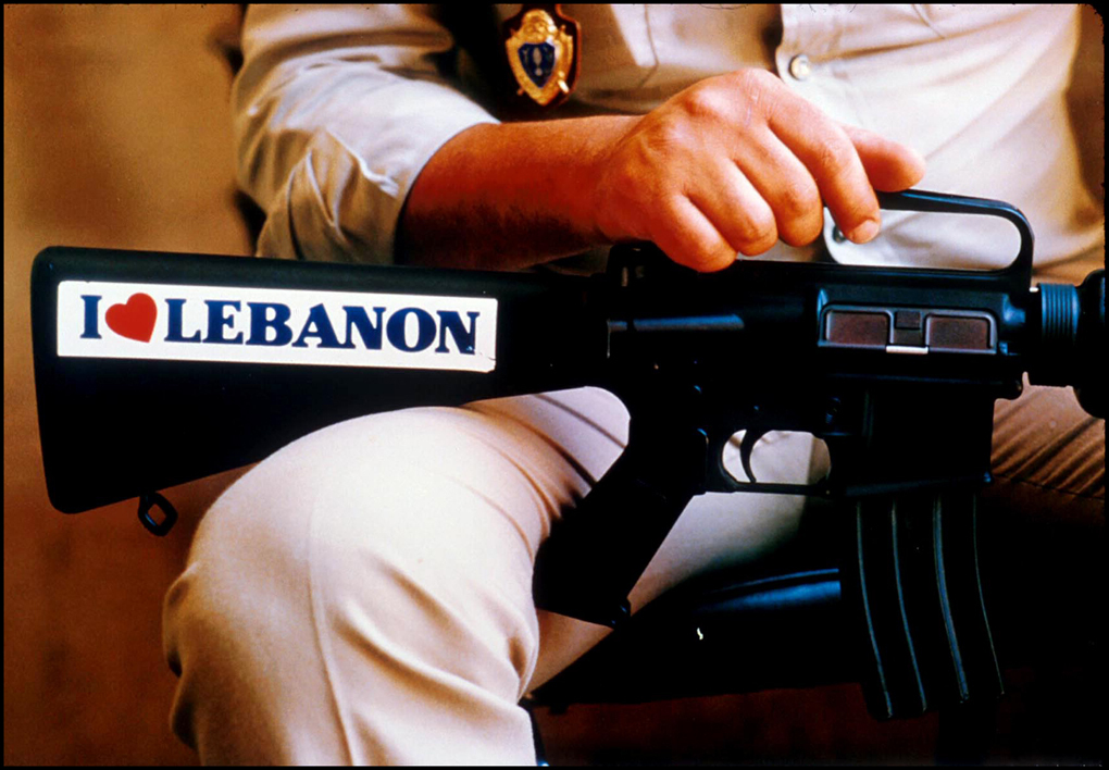 Lebanese policeman holds M-16 rifle at Parliament Building.Beirut 1984 : Lebanon 1981-2008 : BILL FOLEY