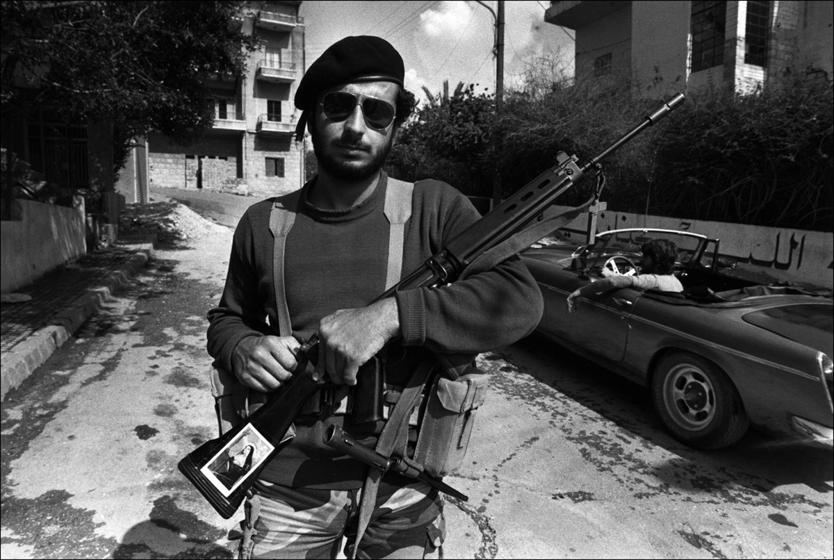 Christian Militaman stands in road, Ashrefiyeh, East Beirut. 1981. : Lebanon 1981-2008 : BILL FOLEY