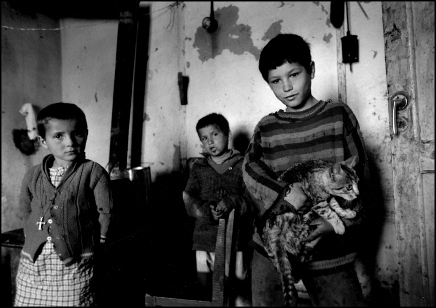 Kids in Village home with cat, Elbasan, Albania 1992 : Albania 1992 : BILL FOLEY