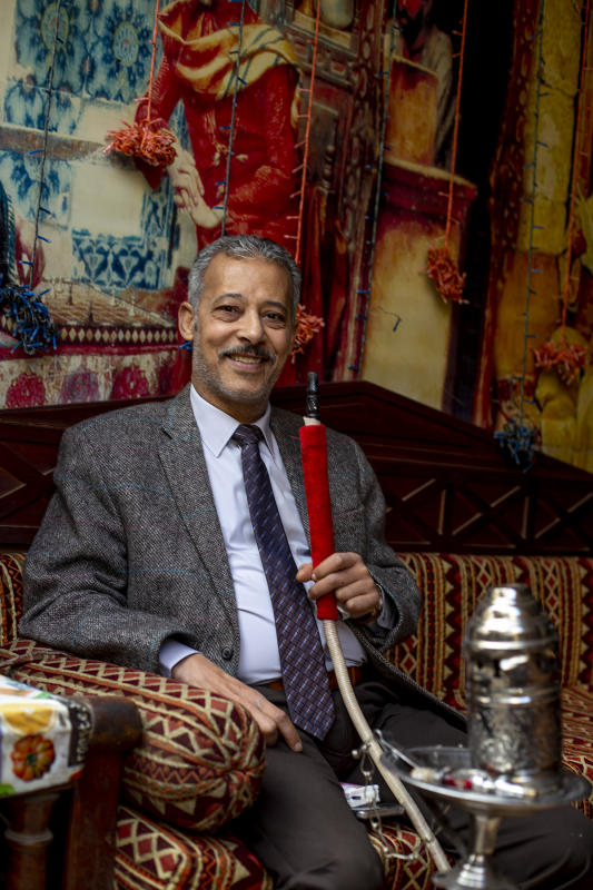 Mr. Hasan enjoys his pipe in Cairo cafe December 2018 : Egypt 1978-2018 : BILL FOLEY