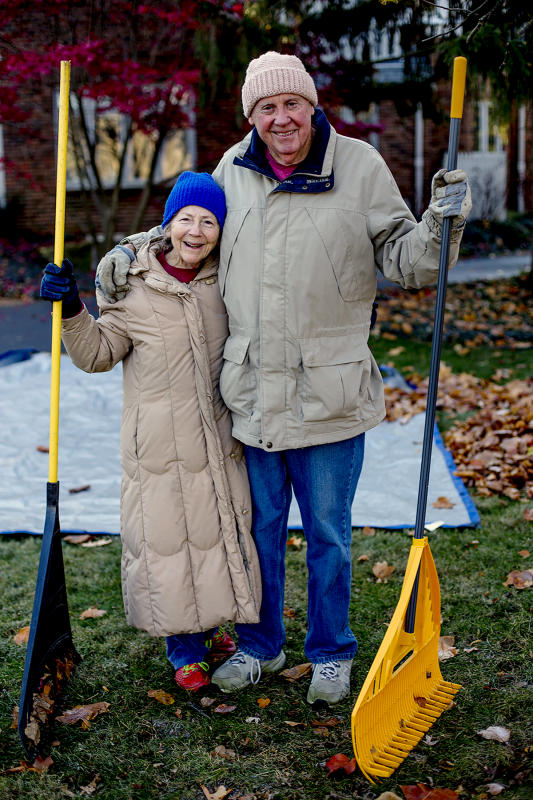 Beth and Carl relax for a minute while raking leaves 2019.